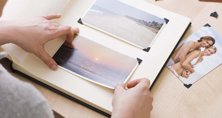 Hands organizing photo album