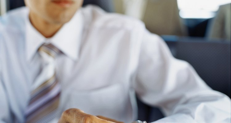 businessman adjusting his watch