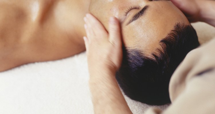 Young man lying in beauty parlour, elevated view