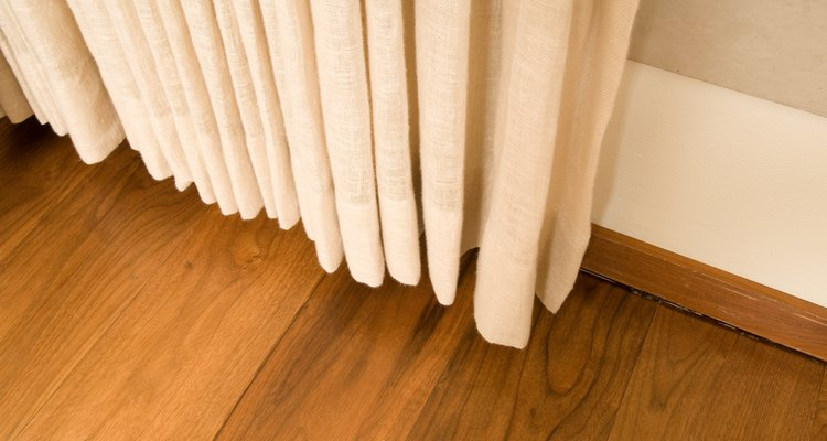 Insulated curtains can be mounted along a staircase.