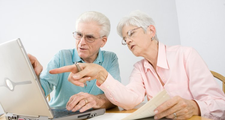 Couple at table with laptop computer