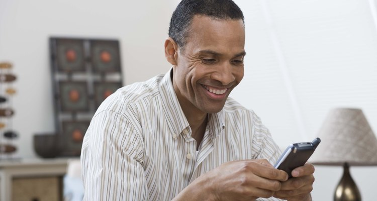 Man texting on cell phone