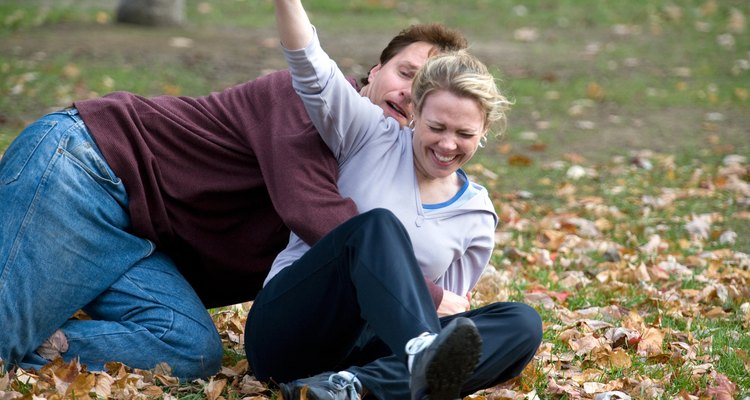 Couple playing football in park