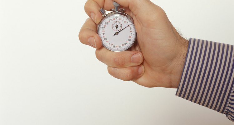 Man holding stopwatch, Close-up of hand