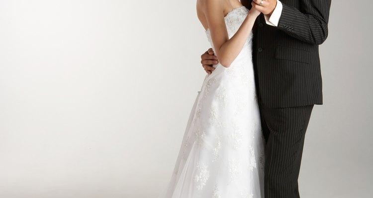 Studio shot of wedding bride and groom dancing