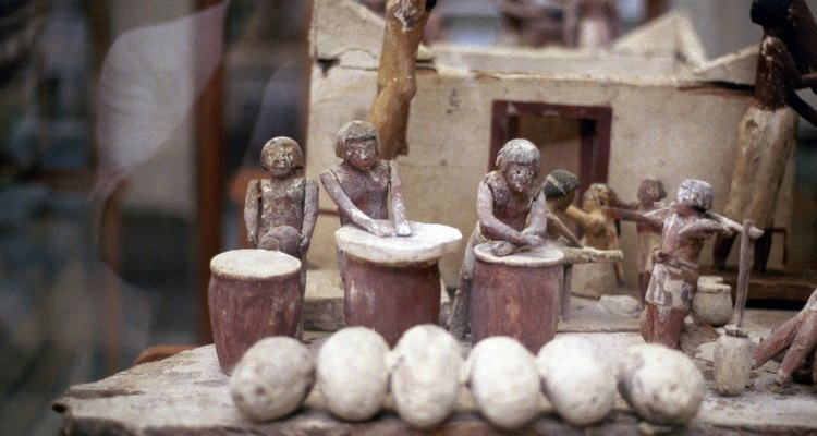 This ancient Egyptian tomb offering of a model bakery shows the square building style.