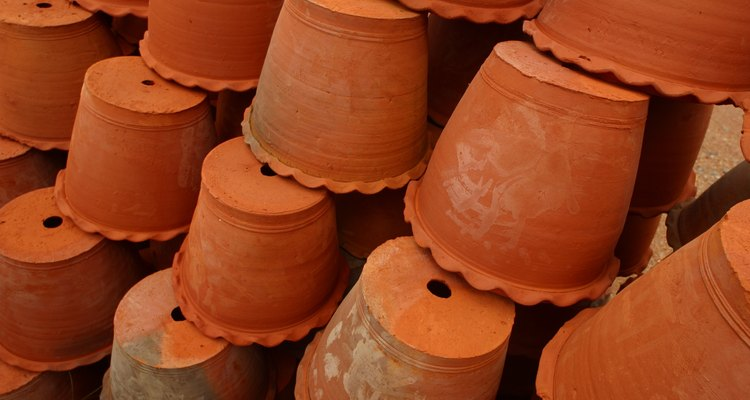 Clay pots have a hole in the bottom, perfect for inserting a solar light.