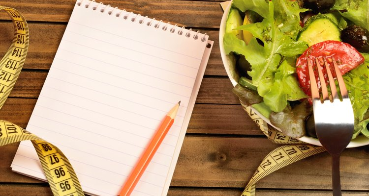 Vegetable salad and notepad
