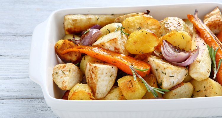 Potatoes baked with carrots and onions