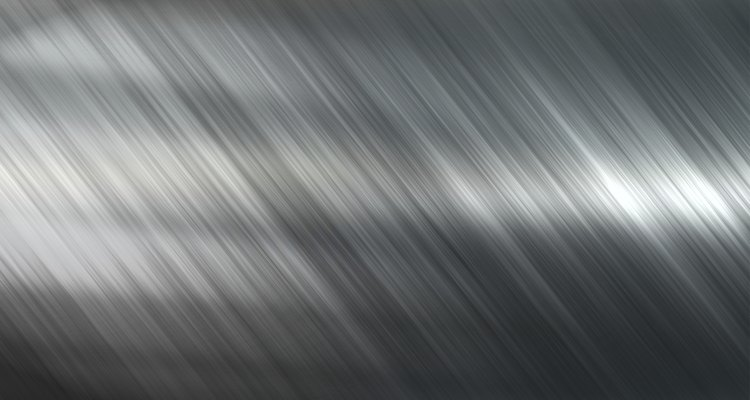 Background or texture of dark brushed steel plate