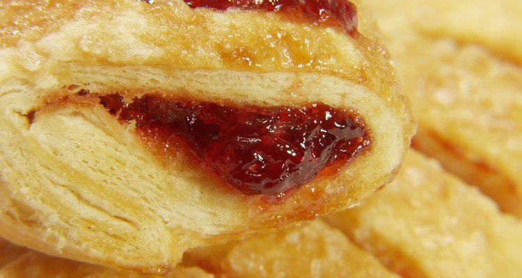 Puff pastry filled with fruits may sometimes escape through the scored lines.