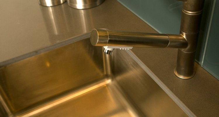 Never scrub a stainless steel sink with abrasive cleaners.