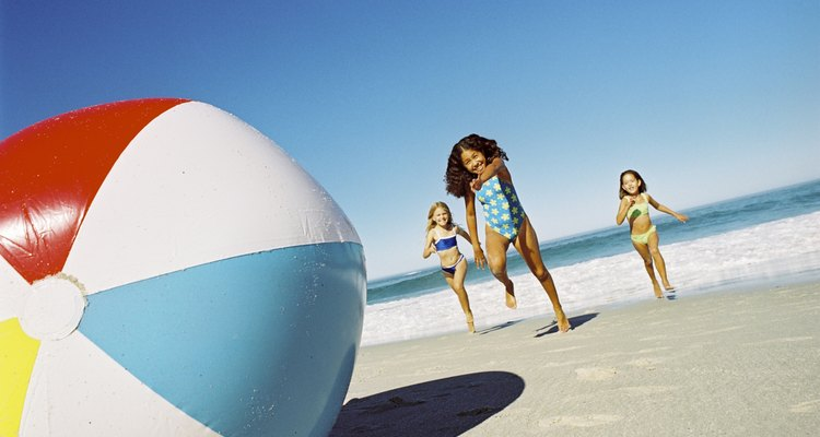 Girls playing with a beach ball