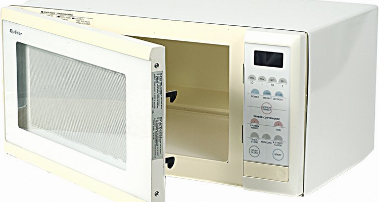Clean a microwave oven after each use.
