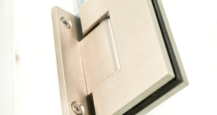 Frameless pivot shower doors have a few different hinge styles.