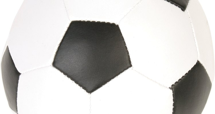 The outer covering of this football is comprised of many pentagons stitched together.
