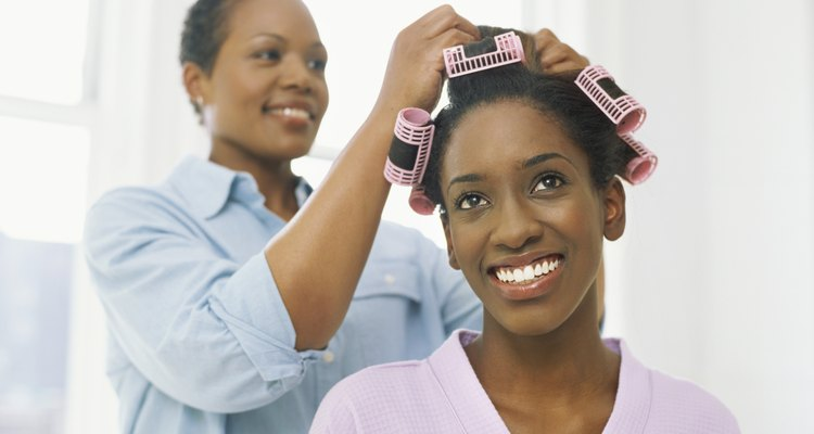 low angle view of a mother putting curlers in her daughter's hair