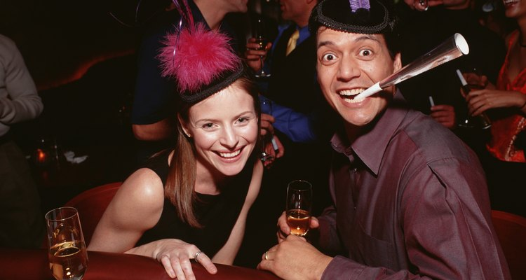 Couple in party hats celebrating