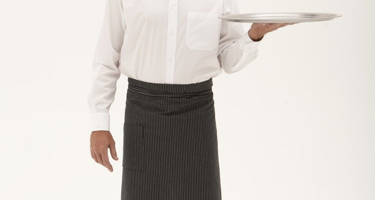A Greek waiter's costume is inevitably black and white.