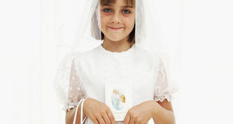 Portrait of a girl (8-10) wearing her first holy communion dress