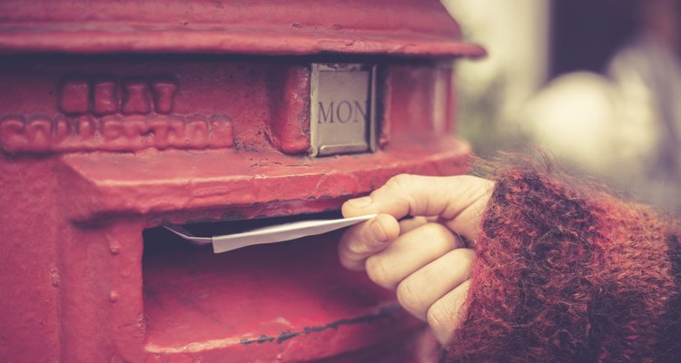 Woman posting letter