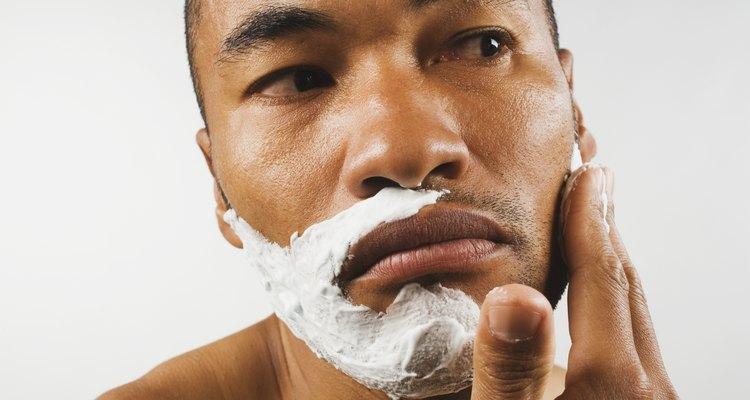 Asian man applying shaving cream