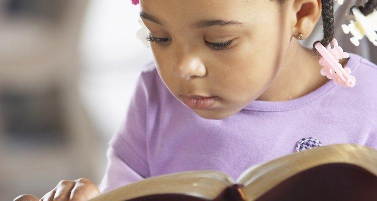 Little girl reading bible