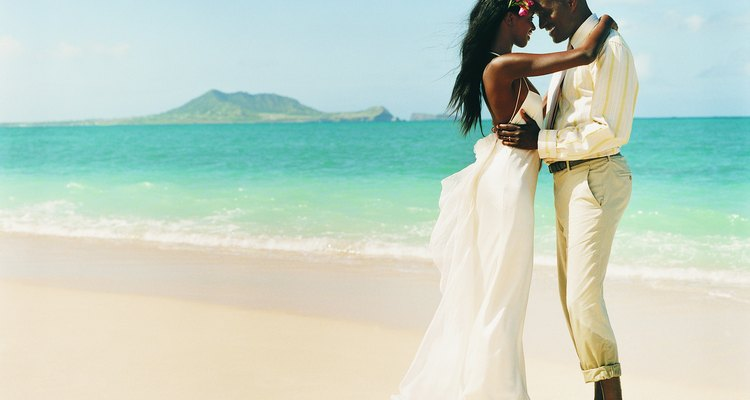 Newlywed Couple Dance Face-to-Face at the Waters Edge on a Beach