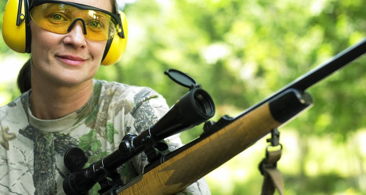 Caucasian Woman Holding A Rifle And Smiling