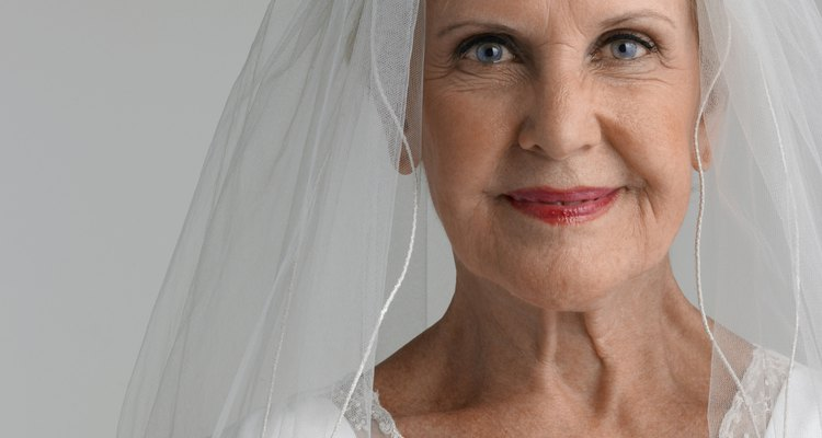 Senior woman wearing wedding dress, portrait