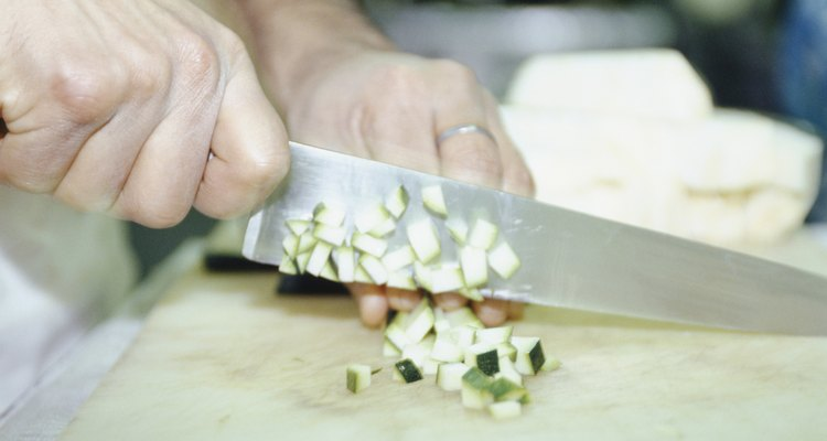 Chef chopping vegetables, mid section