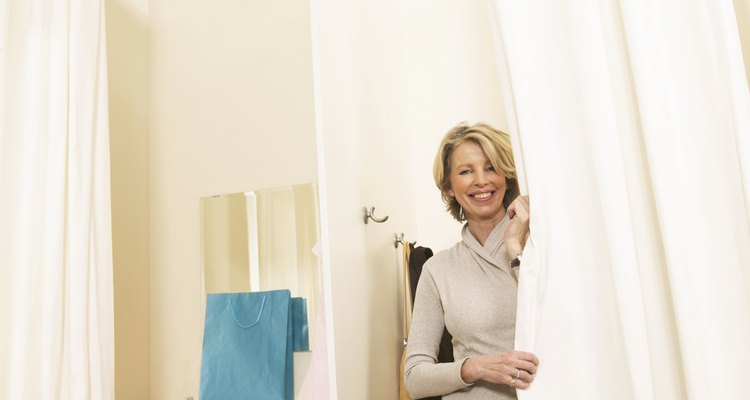 Mature woman in changing room, smiling, portrait