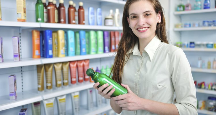 Woman buying shampoo at the pharmacy
