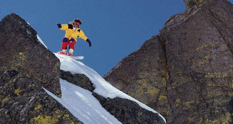 Man snowboarding on rocky slope