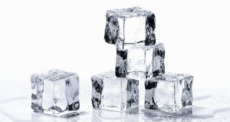 The white flakes that can sometimes be seen in ice cubes are harmless carbonates.