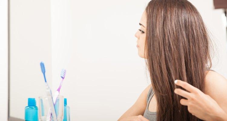 Brunette brushing her hair in the bathroom