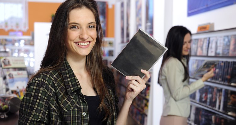 video store: young woman holding a dvd