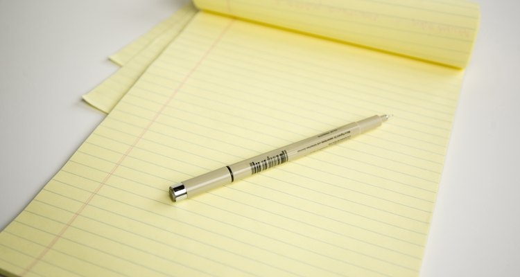 Yellow legal pad with pen