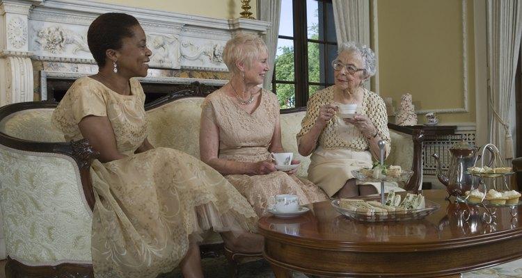 Two senior women and mature woman having tea