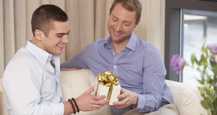 Gay couple exchanging a gift.