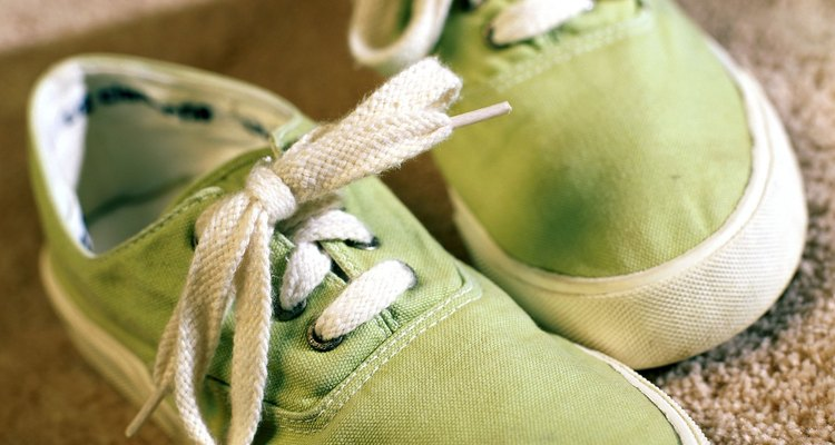 pair of green canvas shoes on carpet