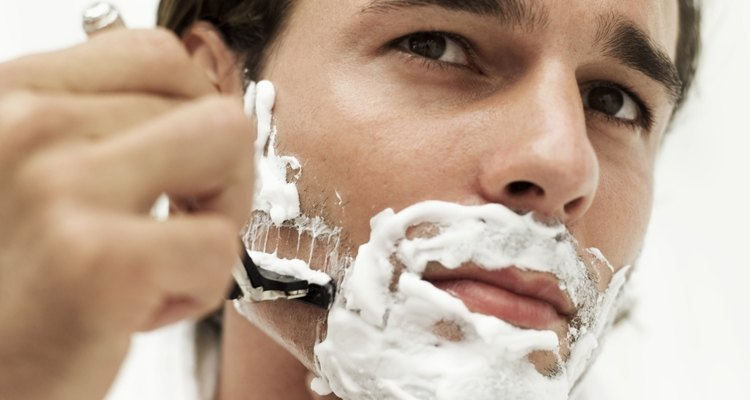 close-up of man shaving