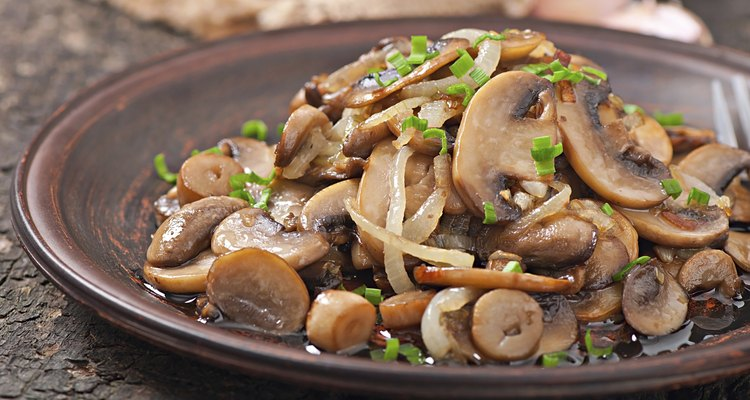 Fried mushrooms and onions on a ceramic plate