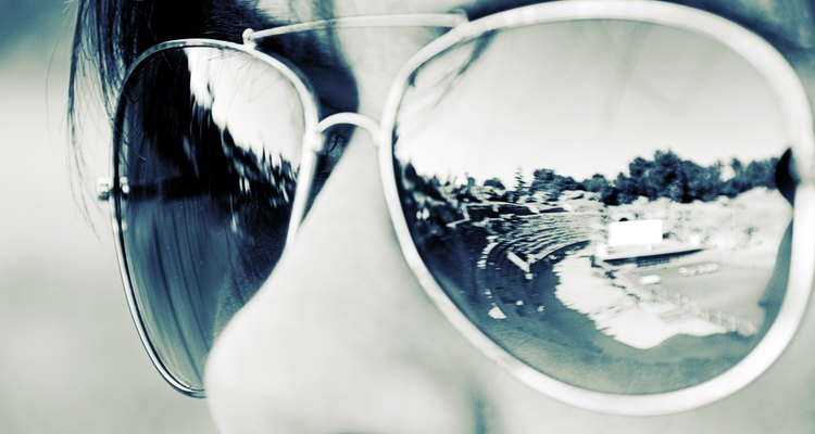 Spanish archaeological site reflected in woman's sunglasses