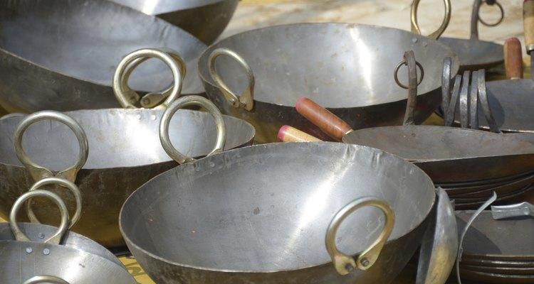 Woks de acero inoxidable.