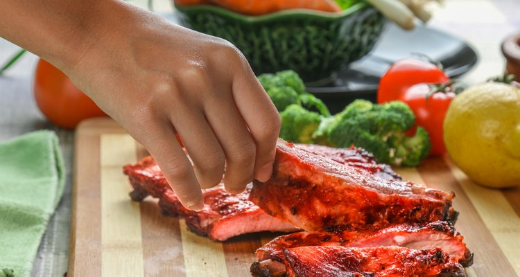woman's hand pick up a BBQ Spare ribs