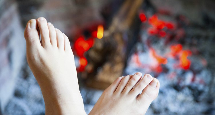 Feet are heated in the fire place