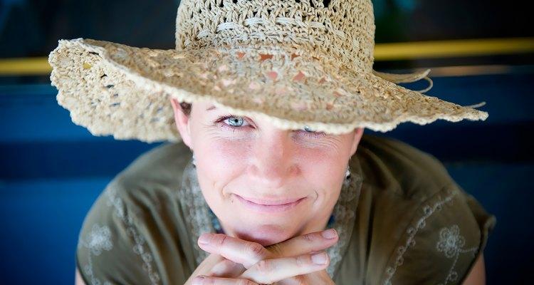 Woman with straw hat flirts