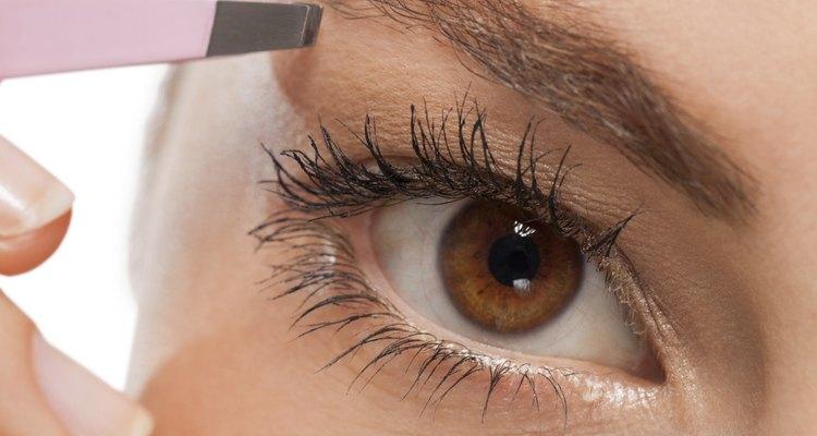 youtg beautiful woman eyebrow plucking tweezers eyes hair