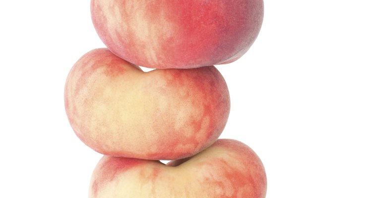 The doughnut peach is flatter than a regular peach.